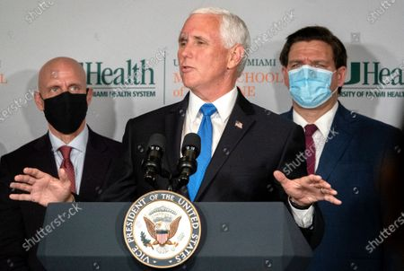 Vice President Mike Pence speaks in the Press Briefing after the roundtable with university leadership and researchers on the progress of a Coronavirus vaccine, at the UHealth Don Soffer Clinical Research Center in Miami, Florida, USA, 27 July 2020. Pence traveled to Miami to mark the beginning of Phase III trials for a Coronavirus vaccine. Next to Pence is the Dr. Stephen M. Hahn, Commissioner of Food and Drugs Administration (FDA) (L) and Ron DeSantis, Florida's Governor.