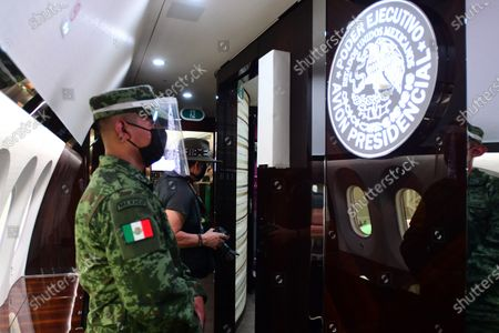 Stock Picture of A soldier guards inside the Mexican presidential plane, a Boeing 787 acquired during the past administration, in the hangar of military base 19 of the Benito Juarez International Airport, in Mexico City, Mexico, 27 July 2020. The Mexican presidential plane was used by Enrique Pena Nieto and his successor, Andres Manuel Lopez Obrador, wants to sell for $130 million.