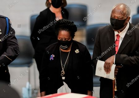 United States Representative Sheila Jackson Lee (Democrat of Texas), left, and US Representative Danny Davis (Democrat of Illinois), right, pay their respects as US Representative John Lewis (Democrat of Georgia) lies in state at the U.S. Capitol Rotunda in Washington, D.C. in Washington, D.C. Lewis, a civil rights icon and fierce advocate of voting rights for African Americans, will lie in state at the Capitol. Lewis died on July 17 at the age of 80.