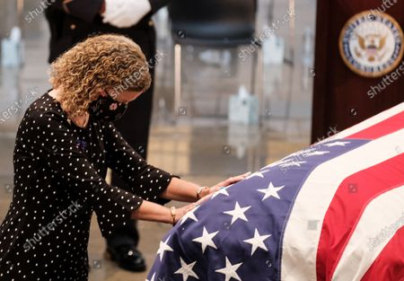 United States Representative Debbie Wasserman Schultz (Democrat of Florida) pays her respects as United States Representative John Lewis (Democrat of Georgia) lies in state at the U.S. Capitol Rotunda in Washington, D.C. in Washington, D.C. Lewis, a civil rights icon and fierce advocate of voting rights for African Americans, will lie in state at the Capitol. Lewis died on July 17 at the age of 80.