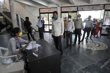 A government employee registers people of Noida authority for coronavirus testing, at Indira Gandhi Kala Kendra, Sector 6 on July 27, 2020 in Noida, India.  (Photo by Sunil Ghosh/Hindustan Times) To go with Vinod Rajput's story