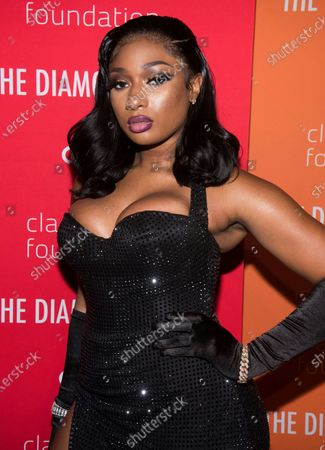 """Megan Thee Stallion attends the 5th annual Diamond Ball benefit gala, in New York. The rapper says she was shot in both feet and gave new details about what she called """"the worst experience of my life"""" in an emotional online video. She once again declined to name who shot her. Police say that rapper Tory Lanez, who was with Megan Thee Stallion on the morning of the shooting, was arrested on suspicion of having a concealed weapon"""