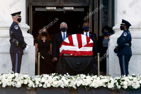 Karen Pence, from left, Vice President Mike Pence, Housing and Urban Development Secretary Ben Carson and his wife Candy Carson stand in front of the flag-draped casket of Rep. John Lewis, D-Ga., as he lies in state on the East Front Steps of the Capitol in Washington