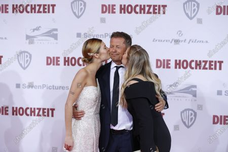 Til Schweiger and Luna Schweiger and Lilli Schweiger  on the red carpet in front of the Zoo Palace.