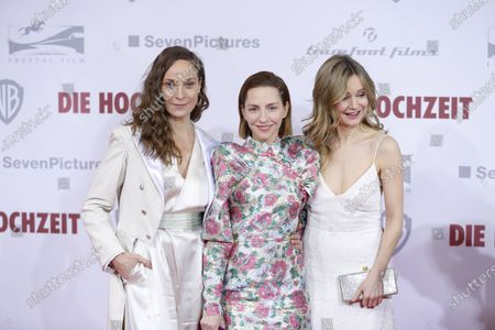 Jeanette Hain, Katharina Schüttler and Stefanie Stappenbeckon the red carpet in front of the Zoo Palace.
