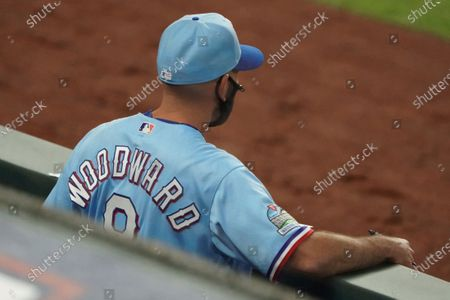 Texas Rangers manager Chris Woodward is pictured in the dugout in a baseball game against the Colorado Rockies, in Arlington, Texas