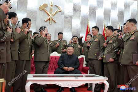 A photo released by the official North Korean Central News Agency (KCNA) shows Kim Jong-Un (C), chairman of the Workers' Party of Korea, chairman of the State Affairs Commission of the Democratic People's Republic of Korea and supreme Commander of the armed forces of the DPRK, conferring 'Paektusan' commemorative pistols on leading commanding officers of the armed forces of the DPRK on the occasion of the 67th anniversary of the Korean people's victory in the great Fatherland Liberation War