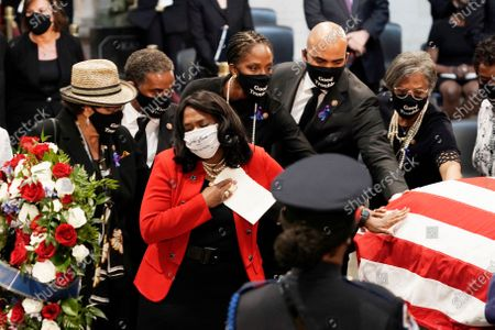 United States Representative Terri Sewell (Democrat of Alabama), and other members of the Congressional Black Caucus, depart at the conclusion of a service for the late US Representative John Lewis (Democrat of Georgia), a key figure in the civil rights movement and a 17-term congressman from Georgia, as he lies in state at the Capitol in Washington,.