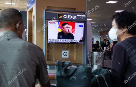 People watch a news broadcast, regarding North Korean leader Kim Jong-un, on a television at Seoul Railway Station in Seoul, South Korea, 28 July 2020. According to media reports on 28 July, North Korean leader Kim Jong-un said the country's nuclear weapons will permanently guarantee national security, as he marked the anniversary of the end of the 1950-53 Korean War.