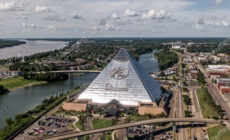 An aerial photo taken with a drone shows the Pyramid, a former sports arena now occupied by Bass Pro Shops near the Mississippi River, in Memphis, Tennessee, USA, 27 July 2020. Memphis was founded in 1819 and is known internationally for music, barbeque, St. Jude Children's Research Hospital, the home of singer Elvis Presley, and its place on the Mississippi River.