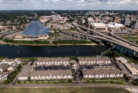 Stock Image of An aerial photo taken with a drone shows condos and the Pyramid, a former sports arena occupied by Bass Pro Shops in Memphis, Tennessee, USA, 27 July 2020. Memphis was founded in 1819 and is known internationally for music, barbeque, St. Jude Children's Research Hospital, the home of singer Elvis Presley, and its place on the Mississippi River.