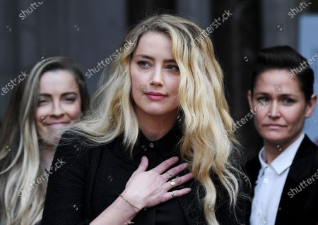 Amber Heard makes a statement outside court
