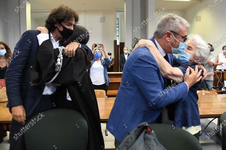 Italian right-to-die activists Marco Cappato and Mina Welby with lawyers after the court's acquittal sentence