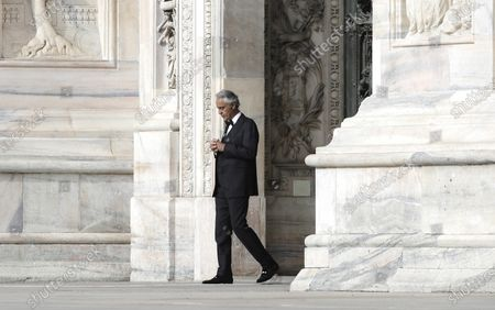 """Stock Picture of In this, Italian singer Andrea Bocelli performs outside the Duomo cathedral, in Milan, Italy. Italian tenor Andrea Bocelli, who had COVID-19, says the pandemic lockdown in his country made him feel """"humiliated and offended"""" for depriving him of freedom. Bocelli spoke at a panel held on Monday in a Senate conference room, where he was introduced by right-wing opposition leader Matteo Salvini, who has railed against the government's stringent measures aimed at reining in the coronavirus outbreak"""