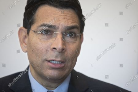Israel's outgoing ambassador to the United Nations Danny Danon speaks during an interview with The Associated Press in the central Israeli city of Ra'anana, . Danon affirmed the country's bond with the Trump administration, dismissing notions that Israel would pay a price for its tight ties to the divisive president should he be defeated in November. Danon said he was relieved that the more radical forces in the Democratic Party failed to win the party's nomination and that Israel could prosper with either Trump or Joe Biden in the White House