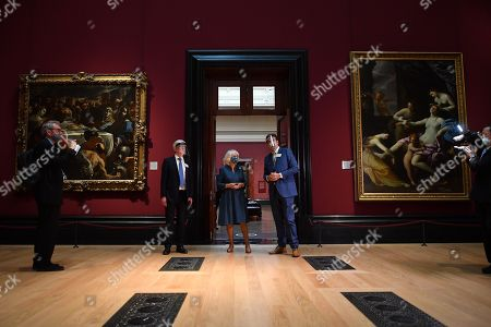Camilla Duchess of Cornwall (C) flanked by National Gallery Director Gabriele Finaldi (R) and Chair of the Board of Trustees Tony Hall visits the newly refurbished Room 32 as she visits the recently reopened National Gallery in London on July 28, 2020.