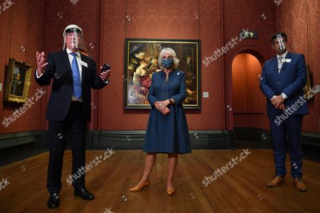 Chair of the Board of Trustees Tony Hall (L) gives a speech as Camilla Duchess of Cornwall (C) and National Gallery Director Gabriele Finaldi look on during a visit to the recently reopened National Gallery in London on July 28, 2020.