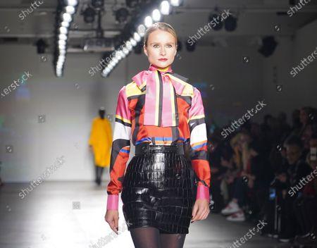 Elena Kurnosova walks runway for Zang Toi collection during Fashion Week at Pier 59