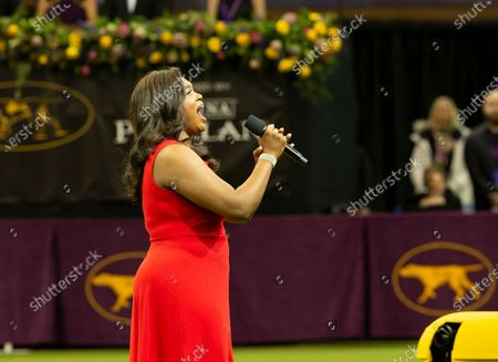 Stock Picture of Metropolitan Opera singer Angel Blue performs National Anthem at 144th Westminster Kennel Club Dog Show at Madison Square Garden