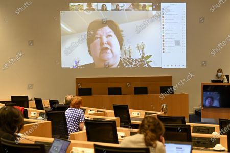 Minister of Health, Social Affairs, Asylum Policy and Migration Maggie De Block pictured on a videoscreen during a hearing of the parliamentary commission of health regarding the Covid-19 crisis, at the federal parliament, in Brussels, Tuesday 28 July 2020.