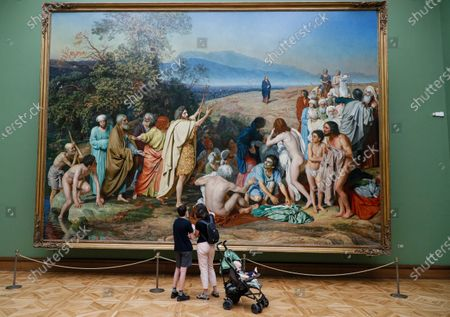 Stock Image of Visitors examine the painting 'The appearance of Christ to the people' of famous Russian artist Alexander Ivanov at the State Tretyakov Gallery in Moscow, Russia, 28 July 2020. All museums and art galleries reopened for the public after restrictions imposed in the city during the coronavirus COVID-19 pandemic were lifted.