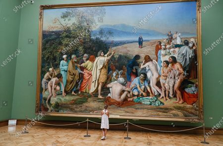 A girl examines the painting 'The appearance of Christ to the people' of famous Russian artist Alexander Ivanov at the State Tretyakov Gallery in Moscow, Russia, 28 July 2020. All museums and art galleries reopened for the public after restrictions imposed in the city during the coronavirus COVID-19 pandemic were lifted.