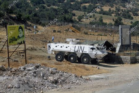 Vehicle manned by Spanish peacekeepers is parked next to a sign showing Hezbollah leader Sayyed Hassan Nasrallah, on the Lebanese side of the Lebanese-Israeli border in the southern village of Chebaa, in southeast Lebanon, . The Israeli military said it thwarted an infiltration attempt Monday by Hezbollah militants, setting off one of the heaviest exchanges of fire along the volatile Israel-Lebanon frontier since a 2006 war between the bitter enemies. Hezbollah denied its members were involved in any activity along the border