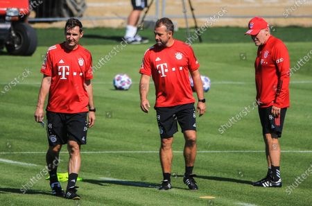 Head coach Hans-Dieter Flick (C), assistant coaches Miroslav Klose (L) and Hermann Gerland of Bayern Munich attend a team training session in Munich, Germany, July 28, 2020. Bayern Munich restarted team training to prepare for the upcoming UEFA Champions League round of 16 second leg match against Chelsea.