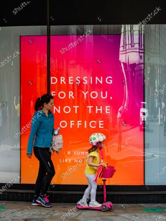 The promotional message is 'Dressing for You, Not the Office, A Summer Like No Other', as People pass the shop windows, some in masks but many not - Peter Jones in Sloane Square, part of John Lewis, is now open as the next stage of the easing of the Coronavirus Lockdown continues.