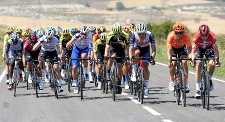 Danish rider Michael Morkov (R) of Deceuninck - Quick Step team leads the pack of cyclists during the first stage of the 42nd Vuelta a Burgos cycling race over 157 kilometers between Burgos' Cathedral and Alto del Castillo in Burgos, Spain, 28 July 2020.