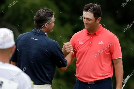 Jon Rahm, of Spain, right, is congratulated by Ryan Palmer after winning the Memorial golf tournament in Dublin, Ohio. The No. 1 player in the world is Rahm. The best player in golf? With this kind of depth, that depends on the week. Rahm begins his new reign hopeful it lasts more than a week