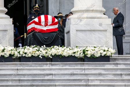 House Majority Leader Steny Hoyer of Md., right, views the flag-draped casket of Rep. John Lewis, D-Ga., as he lies in state on the East Front Steps of the Capitol in Washington