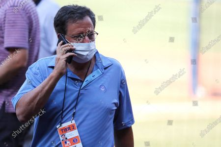 Boston Red Sox chairman Tom Werner talks on the phone prior to a baseball game, at Fenway Park in Boston