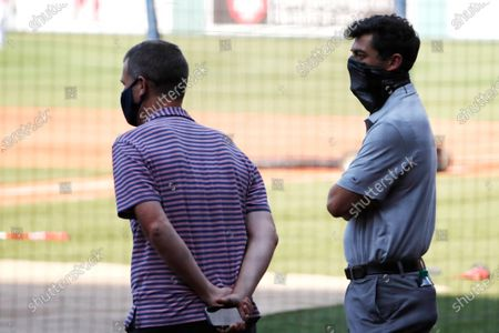 Boston Red Sox president Sam Kennedy, left, and chief baseball officer Chaim Bloom watch batting practice prior to a baseball game, at Fenway Park in Boston