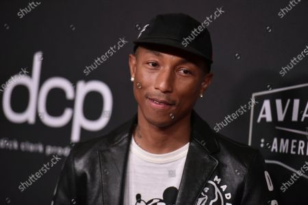 """Stock Photo of Pharrell Williams arrives at the 23rd annual Hollywood Film Awards at the Beverly Hilton Hotel in Beverly Hills, Calif. Grammy-winners including Williams, the Beastie Boys and Nine Inch Nails' Trent Reznor have a chance of winning their first-ever honors at the Emmy Awards. Williams is nominated for outstanding original music and lyrics for """"Letter to My Godfather"""" from """"The Black Godfather,"""" the Netflix documentary about music executive Clarence Avant"""