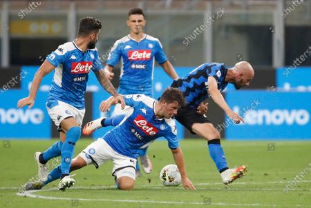 Napoli's Diego Demme, centre, tries to stop Inter Milan's Borja Valero, right, during the Serie A soccer match between Inter Milan and Napoli at the San Siro Stadium, in Milan, Italy