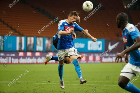 Napoli's Mario Rui, foreground, fights for the ball with Inter Milan's Borja Valero, obscured, during the Serie A soccer match between= Inter Milan and Napoli at the San Siro Stadium, in Milan, Italy