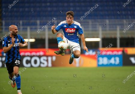 Napoli's Diego Demme, right, controls the ball in front of Inter Milan's Borja Valero, left, during the Serie A soccer match between Inter Milan and Napoli at the San Siro Stadium, in Milan, Italy