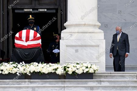 House Majority Leader Steny Hoyer, D-Md., looks at the flag-draped casket of the late Rep. John Lewis, D-Ga., as Lewis lies in state at the top of the East steps on Capitol Hill in Washington