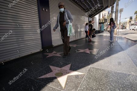 A woman walks past the star of British-US actress Olivia de Havilland on the Walk of Fame in Hollywood, California, USA, 28 July 2020. According to media reports, Olivia de Havilland has died aged 104 in Paris.