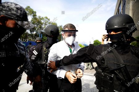 Former Defense Minister David Munguia Payes, accused of breach of duties for alleged involvement in a truce between the country's main gangs, is escorted to a hearing to impose measures, in San Salvador, El Salvador, 28 July 2020. The former Minister of Defense and Security David Munguia Payes and former President Mauricio Funes (2009-2014) were formally accused on 26 July for allegedly favoring the main gangs in the country within the framework of a pact that took place between 2012 and 2014 to lower the homicide figure.
