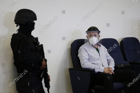 Former Defense Minister David Munguia Payes, accused of breach of duties for alleged involvement in a truce between the country's main gangs, is wearing a face mask while waiting for a hearing to impose measures, in San Salvador, El Salvador, 28 July 2020. The former Minister of Defense and Security David Munguia Payes and former President Mauricio Funes (2009-2014) were formally accused on 26 July for allegedly favoring the main gangs in the country within the framework of a pact that took place between 2012 and 2014 to lower the homicide figure.