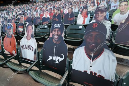Stock Photo of Fan cutouts of former San Francisco Giants Barry Bonds (R-L), former San Francisco 49ers hall of famers, Jerry Rice and 49ers Steve Young on field level seats before the San Francisco Giants home opener MLB game between the San Diego Padres and the San Francisco Giants at Oracle Park, in San Francisco, California, USA, 28 July 2020. The start of the season was delayed due to the coronavirus pandemic.
