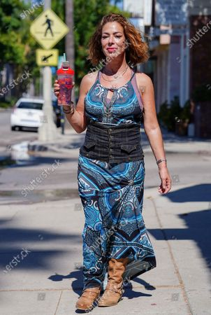 Claudia Wells stops by her clothing store Armani Wells in Studio City