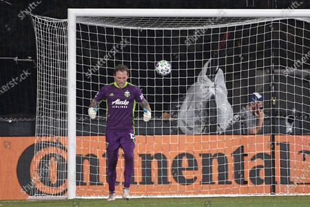 Portland Timbers goalkeeper Steve Clark (12) reacts after a shot by FC Cincinnati defender Kendall Waston went over the net during the penalty shootout in an MLS soccer match, early, in Kissimmee, Fla