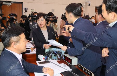 Rep. Cho Soo-jin (2nd from L) of the main opposition United Future Party strongly protests to Rep. Yun Ho-jung (L), chairman of the legislation and judiciary committee, over the unilateral passage of bills to amend housing lease protection laws at the National Assembly in Seoul, South Korea, 29 July 2020, as ruling party lawmakers criticize her.