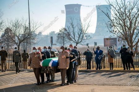 Pallbearers carry the coffin of South African anti-apartheid icon Andrew Mlangeni ahead of his funeral service, in Soweto, South Africa, . Mlangeni, the last remaining survivor of the historic Rivonia Trial that sentenced activists like Nelson Mandela to life imprisonment, died last week aged 95