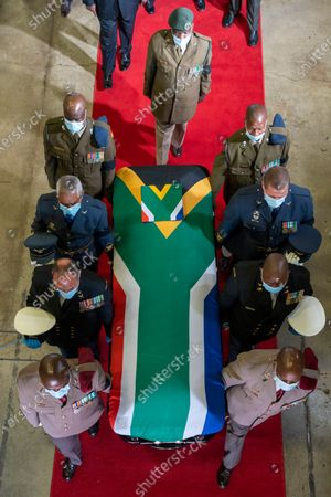 Pallbearers carry the coffin of South African anti-apartheid icon Andrew Mlangeni, after his funeral service, in Soweto, South Africa, . Mlangeni, the last remaining survivor of the historic Rivonia Trial that sentenced activists like Nelson Mandela to life imprisonment, died last week aged 95