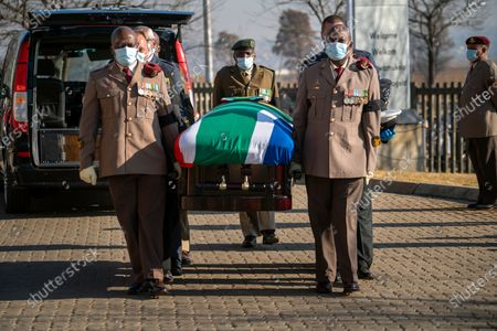 Pall bearers carry the coffin of ANC stalwart Andrew Mlangeni to his funeral service in Soweto, Johannesburg, South Africa, 29 July  2020. Mlangeni died at the age of 95 last week after he was hospitalized following an abdominal complaint. Mlangen was sentenced to life in prison on Robben Island on charges of treason and sabotage on June 12, 1964, and was released in 1989 after negotiations with the apartheid government started.