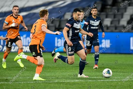 Andrew Nabbout of Melbourne Victory runs at Corey Brown of Brisbane Roar; Bankwest Stadium, Parramatta, New South Wales, Australia; A League Football, Melbourne Victory versus Brisbane Roar.